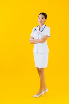 Portrait beautiful young asian woman thai nurse smile happy ready for work for patient