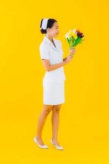 Portrait beautiful young asian woman thai nurse with flower