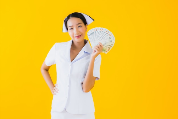 Portrait beautiful young asian woman thai nurse with a lot of cash and money