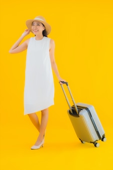 Portrait beautiful young asian woman travel concept with luggage