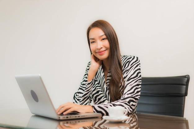 Portrait beautiful young asian woman use computer laptop on working table in room