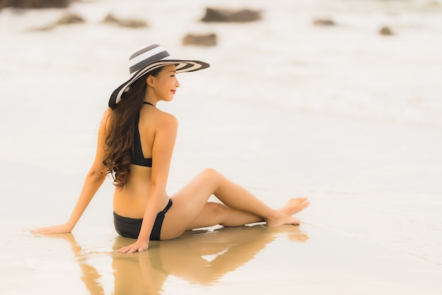 Portrait beautiful young asian woman wear bikini on the beach sea ocean