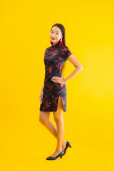 Portrait beautiful young asian woman wear chinese dress with action