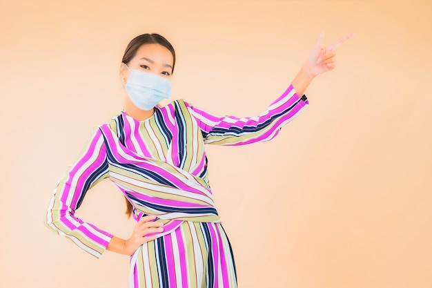 Portrait beautiful young asian woman wear mask for protect corona virus or covid19 on color