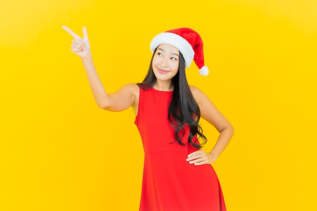 Portrait beautiful young asian woman wear santa hat or hairband on yellow wall