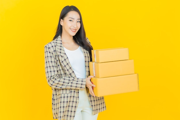 Portrait beautiful young asian woman with box ready for shipping
