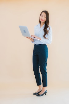 Portrait beautiful young asian woman with computer laptop for work