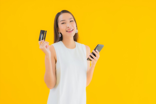 Portrait beautiful young asian woman with credit card for online shopping