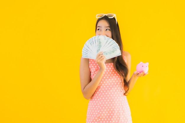 Portrait beautiful young asian woman with a lot of cash