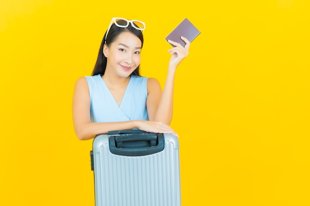 Portrait beautiful young asian woman with luggage bag and passport ready for travel