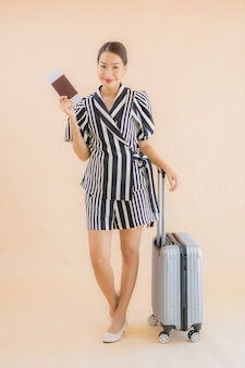 Portrait beautiful young asian woman with luggage bag passport