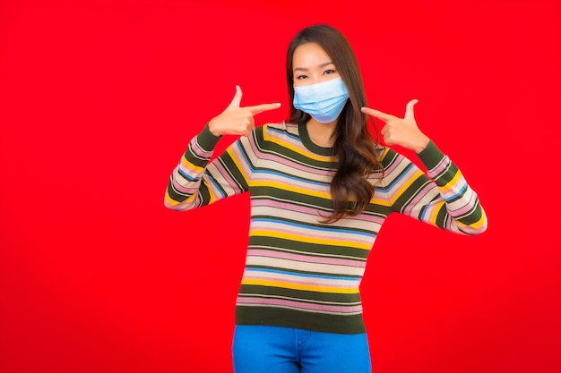 Portrait beautiful young asian woman with mask for protection covid19