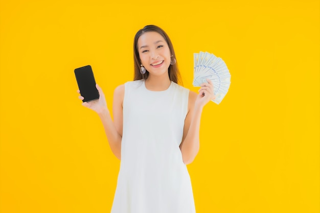 Portrait beautiful young asian woman with money cash