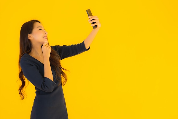 Portrait beautiful young asian woman with phone