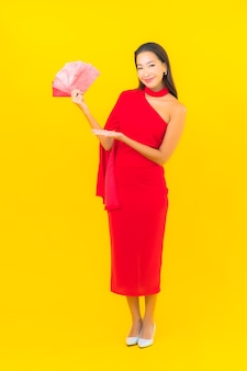 Portrait beautiful young asian woman with red envelope letter
