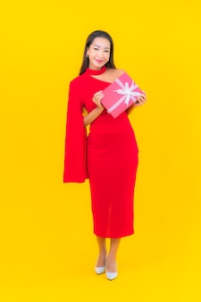 Portrait beautiful young asian woman with red gift box