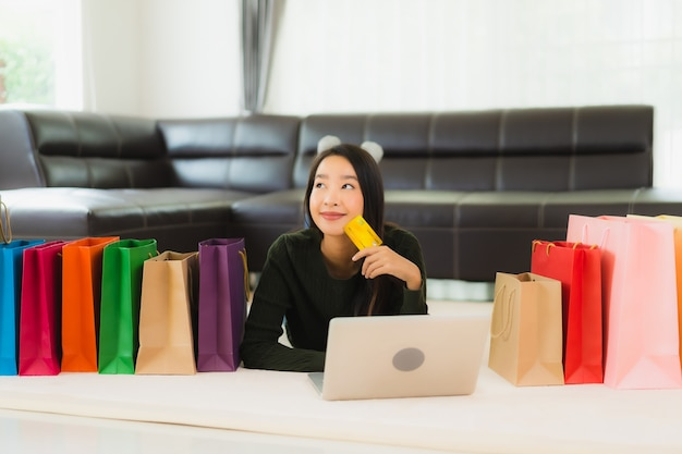 Portrait beautiful young asian woman with shopping bag and credit card