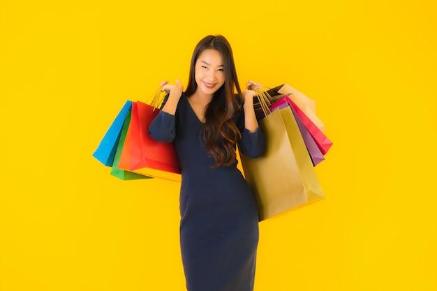 Portrait beautiful young asian woman with shopping bag