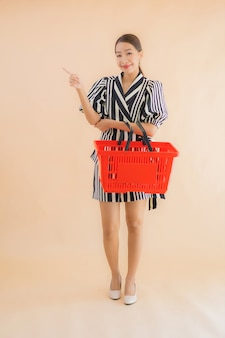 Portrait beautiful young asian woman with shopping basket