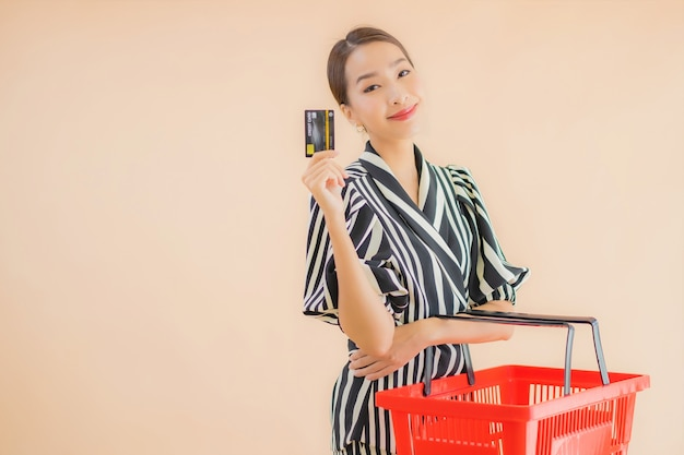 Portrait beautiful young asian woman with shopping basket