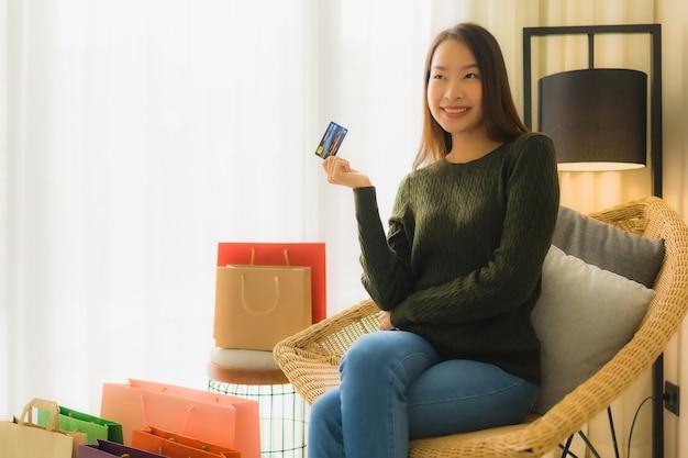 Portrait beautiful young asian women using credit card for online shopping
