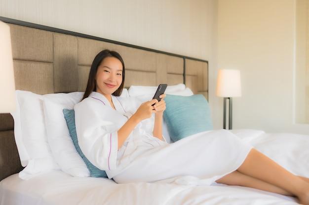 Portrait beautiful young asian women using mobile