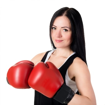 Portrait of a beautiful young brunette woman with red boxing gloves.