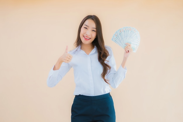 Portrait beautiful young business asian woman with cash or money