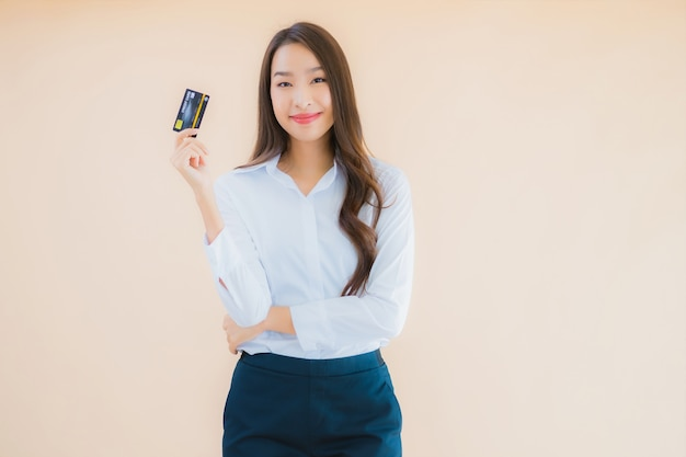 Portrait beautiful young business asian woman with credit card