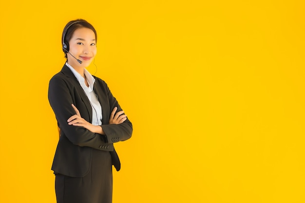 Portrait beautiful young business asian woman with headphone or headset