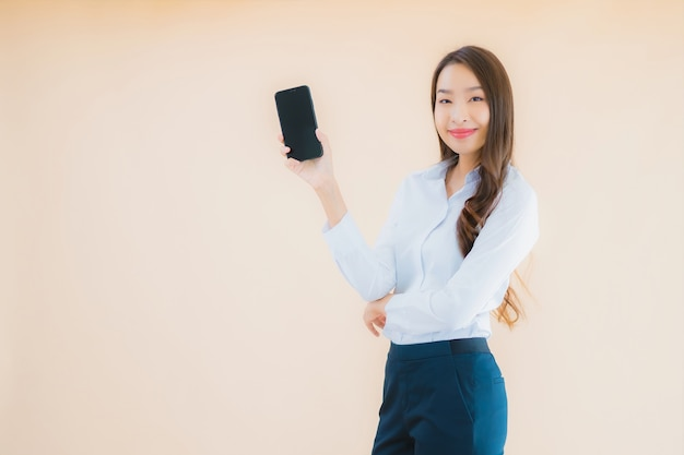 Portrait beautiful young business asian woman with smart mobile phone and coffee cup