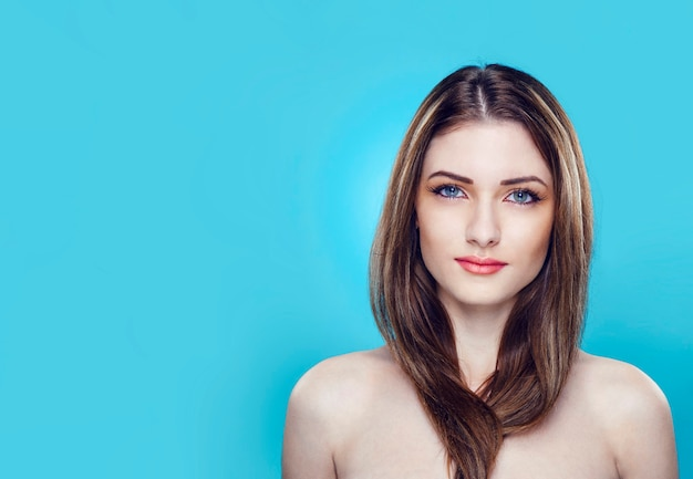 Portrait of a beautiful young female model with bare shoulders with makeup