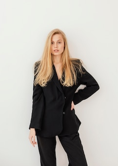 Portrait of beautiful young female wearing formal suit