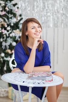 Portrait of a beautiful young girl in elegant christmas decorations
