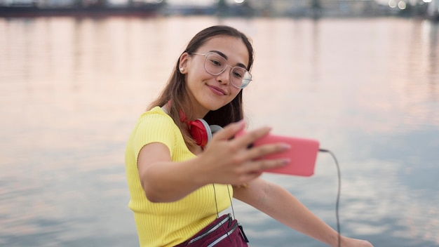 Portrait of beautiful young girl taking a selfie