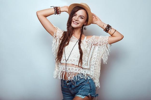 Portrait of beautiful young hippie woman in studio