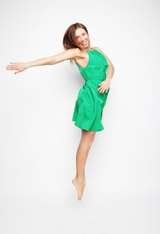 Portrait of a beautiful young lady jumping in joy