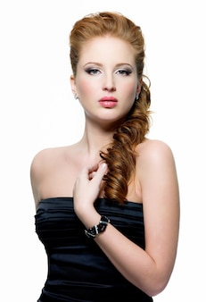Portrait of beautiful young red-haired woman with fashion make-up on white