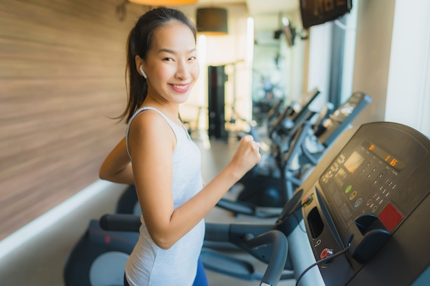 Portrait beautiful young sport asian woman exercise and work out with fitness equipment in gym
