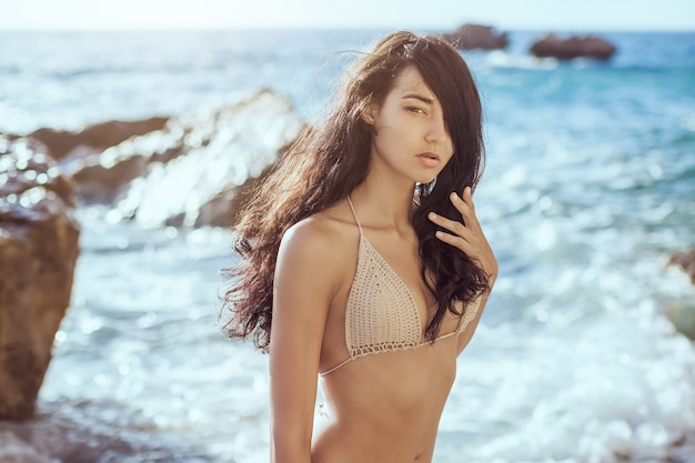 Portrait of beautiful young woman on beach.
