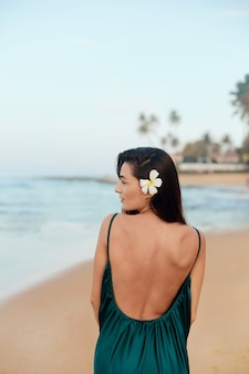 Portrait of beautiful young woman in dress on the beach. pretty girl on tropical beach. freedom concept, holiday, beach
