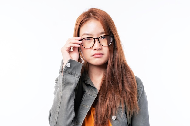 Portrait of a beautiful young woman student with  eye glass - studying online e-learning system