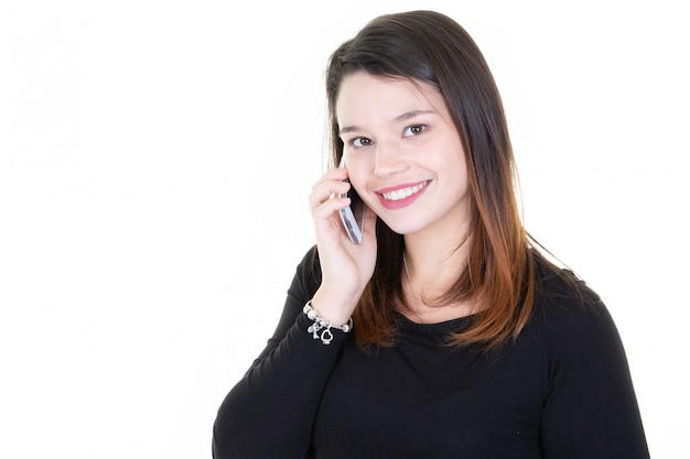 Portrait of beautiful young woman using mobile phone on white background with side copy space