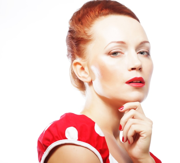Portrait of a beautiful young woman with bright red lips