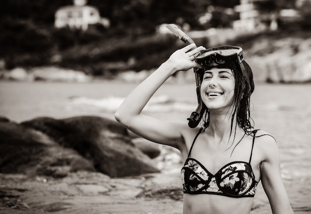 Portrait of the beautiful young woman with the diving mask in the sea in greece.