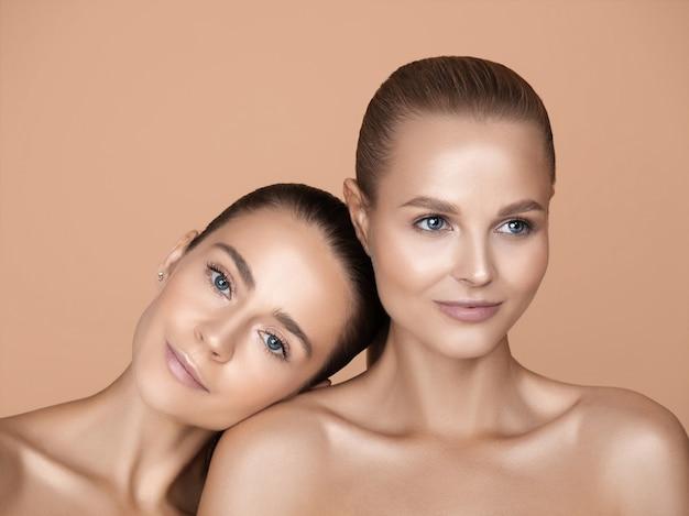 Portrait of beautiful young women on brown studio