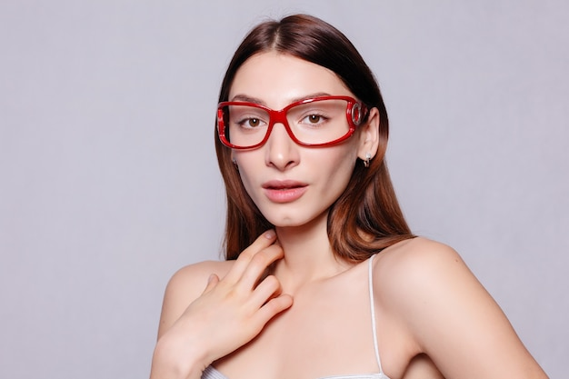 Portrait of beauty girl in eyeglasses white background. close up portrait of young cheerful beautiful girl with dark long hair smiling with teeth, looking in camera happy and relaxed face expression