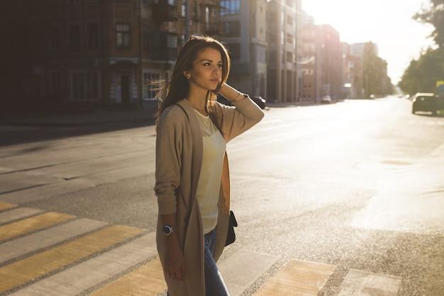 Portrait of beauty woman walking on the street