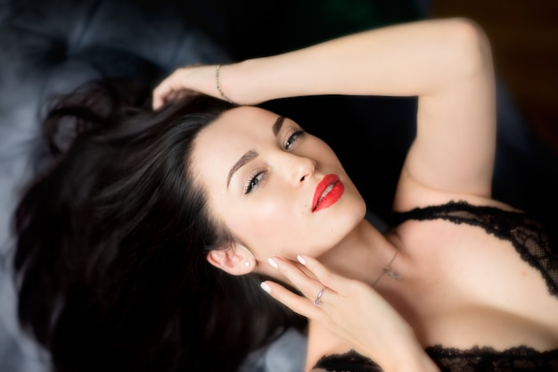 Portrait of beauty young brunette woman with red lips