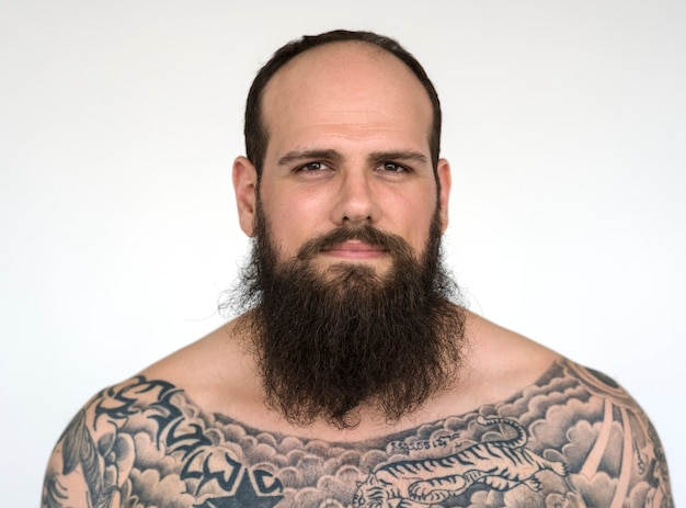 Portrait of a big tattooed bearded man
